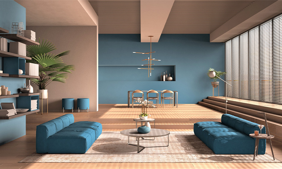 Wall furniture design for hall, a minimalist living room in tones of blue, and peach designed with open wall shelves.