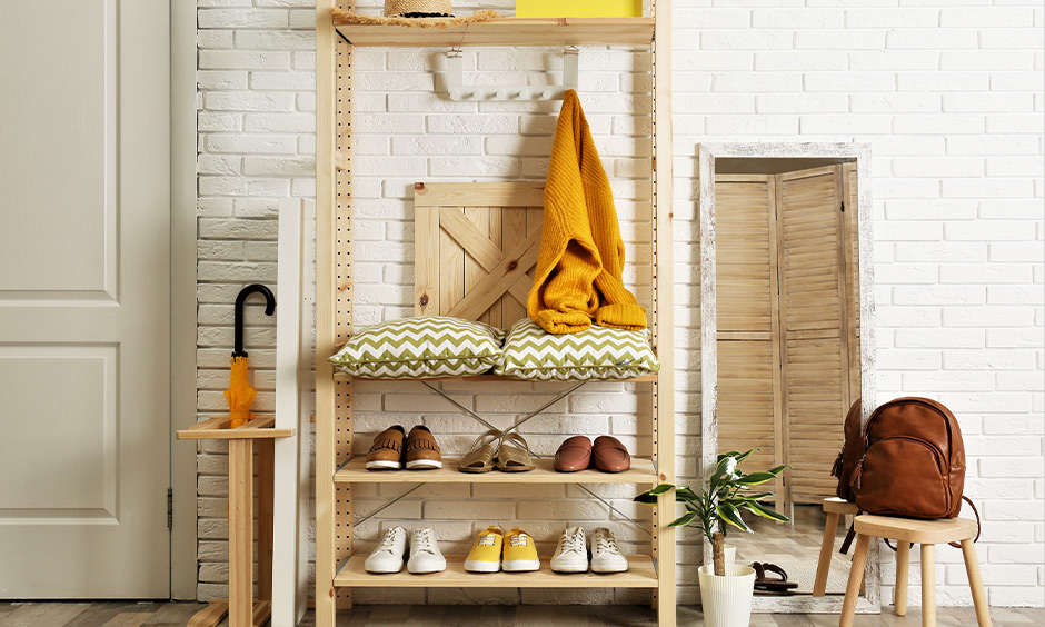 Light wooden rack home furniture design in the hall brings a rustic and warm vibe to the entryway space.