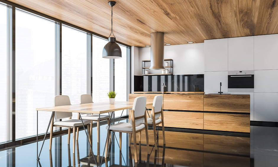 Kitchen design with black floor tiles make your kitchen look spacious and bright