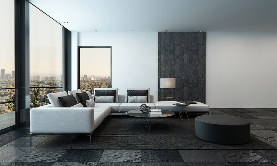 Living room design with black floor tiles with minimal decor