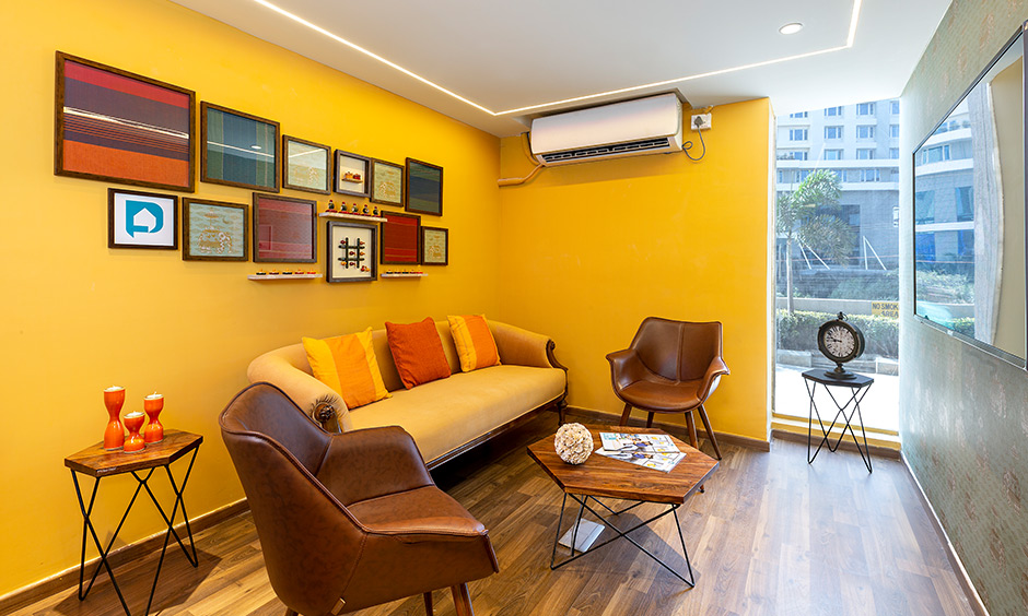 Bright yellow Indian style living room in design cafe Whitefield experience centre looks chic.