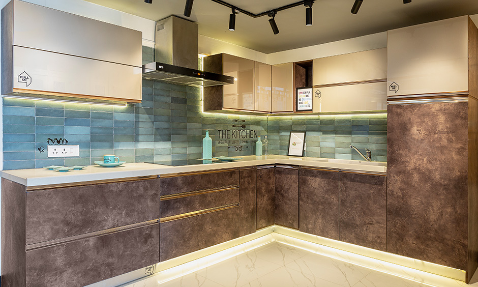 The L-shaped modern eclectic kitchen looks luxury and designed by design cafe interior designer in Whitefield.