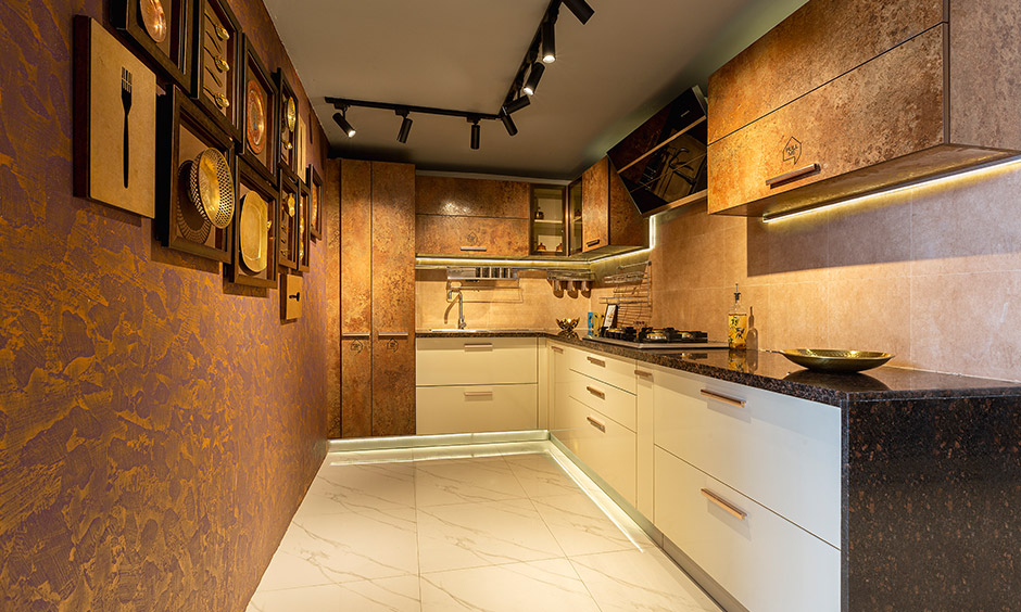 Modern rustic kitchen with cabinets and skirting drawer designed by design cafe is the best interior designer in Whitefield.