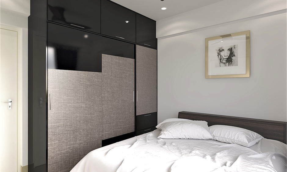 Home decor sliding wardrobe doors in black and silver lamination looks bold in the white bedroom.