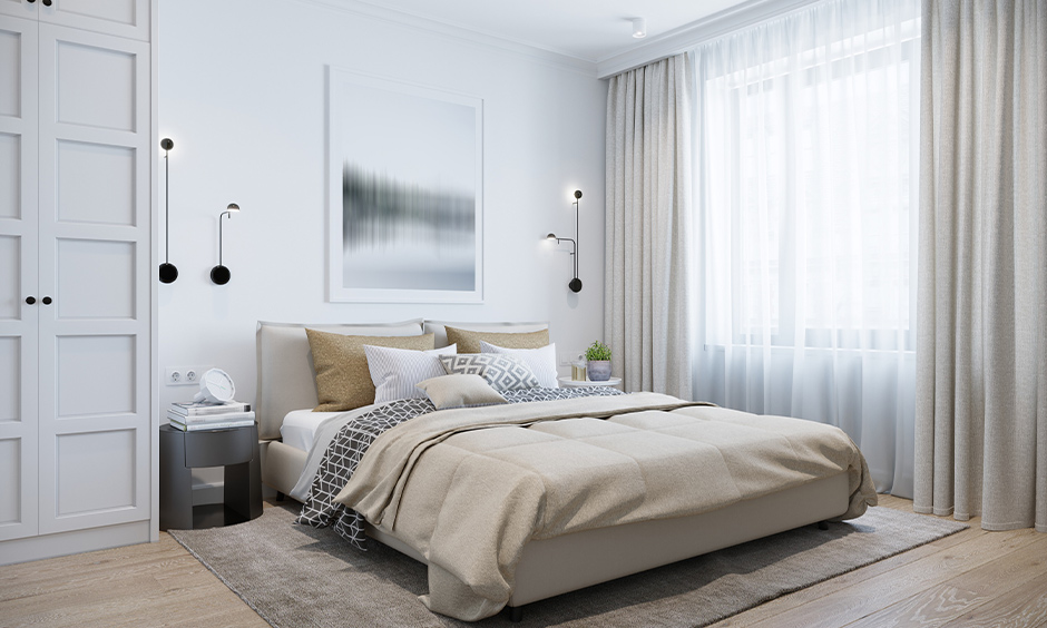 White bedroom with wall-mounted minimalist light bedside design looks modern.