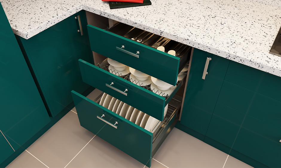Internal drawers are base kitchen units designed in creen coloured internal drawers with cups, spoon and plates stored inside it.