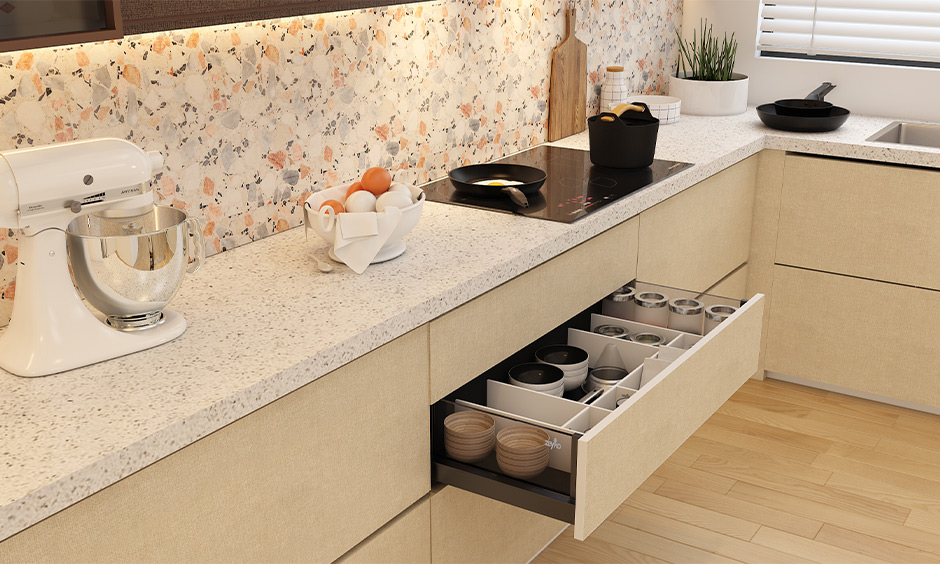 Tandem drawer with pots and pans for clutter-free storage is kitchen storage idea.