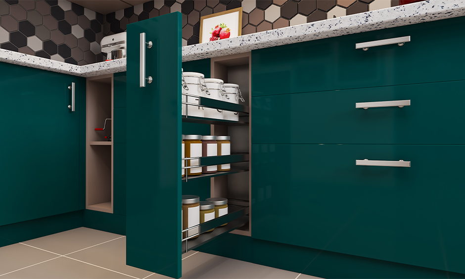 Kitchen storage solution with green coloured spice pull-out unit designed to hold smaller containers in it.