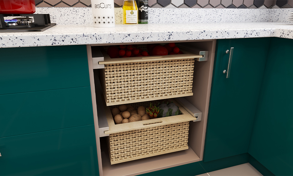 Pull-out basket with fruits and vegetables is an under-sink kitchen storage design.