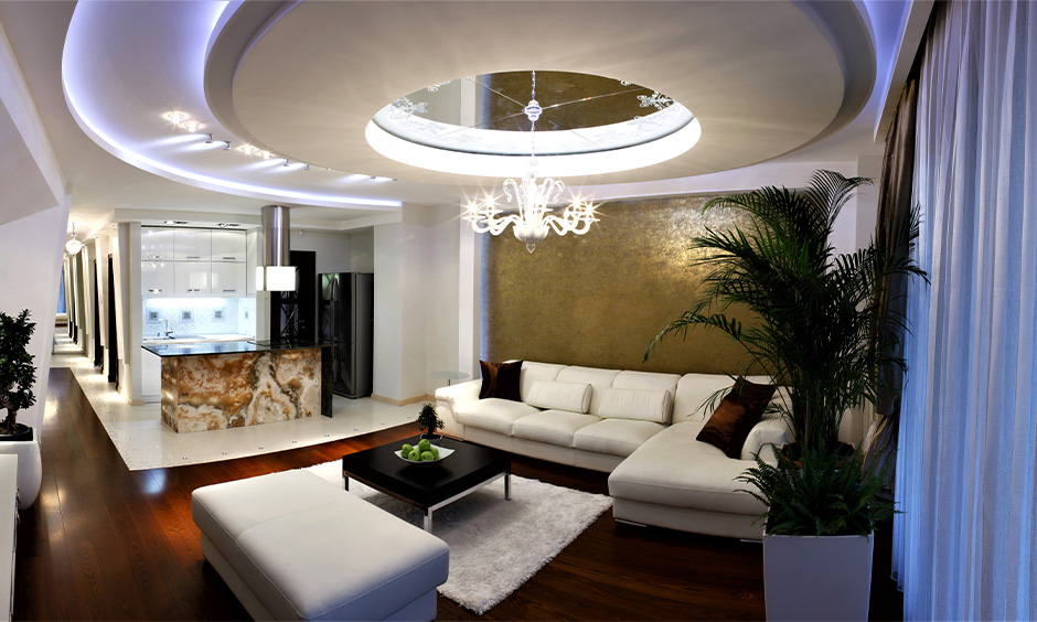 Circular pop ceiling design for drawing room with blue-toned lighting adds a touch of boldness to space.