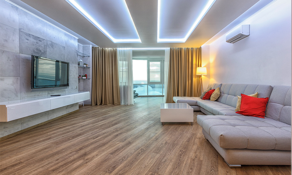 White drawing room pop ceiling with sophisticated lighting brings disco vibe to the area.