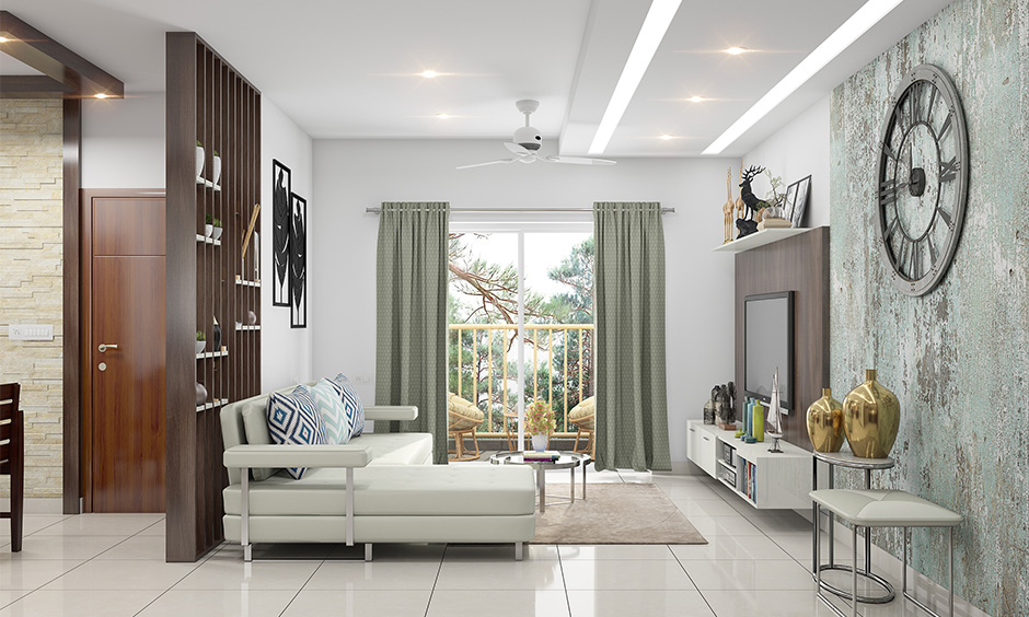 The white living room has a layered modern cove light ceiling.