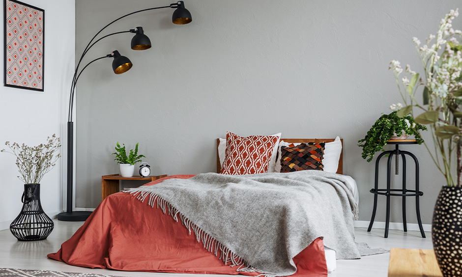 A tall standing lamp with multiple heads in the bedroom looks aesthetic, small bedroom lighting ideas.
