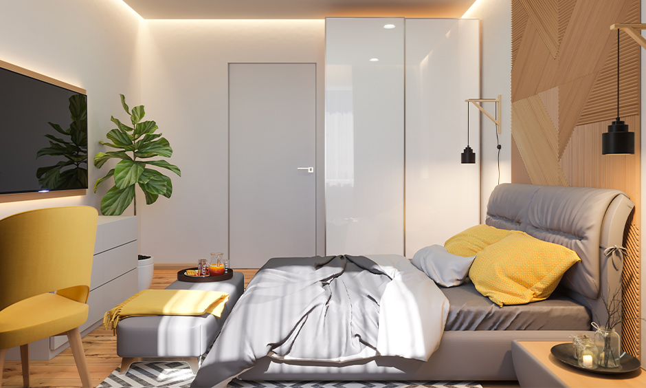 Small bedroom ceiling lighting ideas, bedroom with recessed light and two sidewall light look elegant.