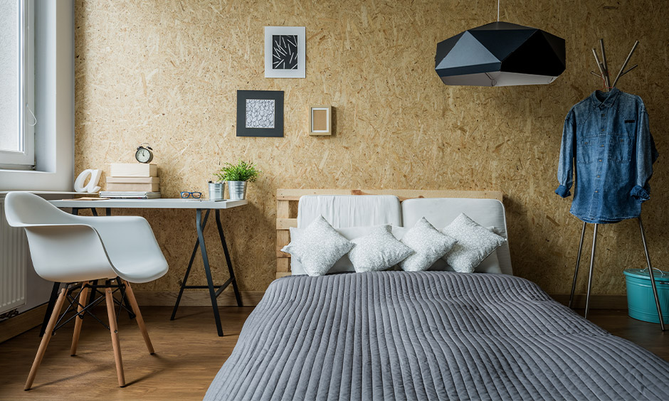 Small bedroom lighting in hexagonal shape hanging from the ceiling looks stylish.