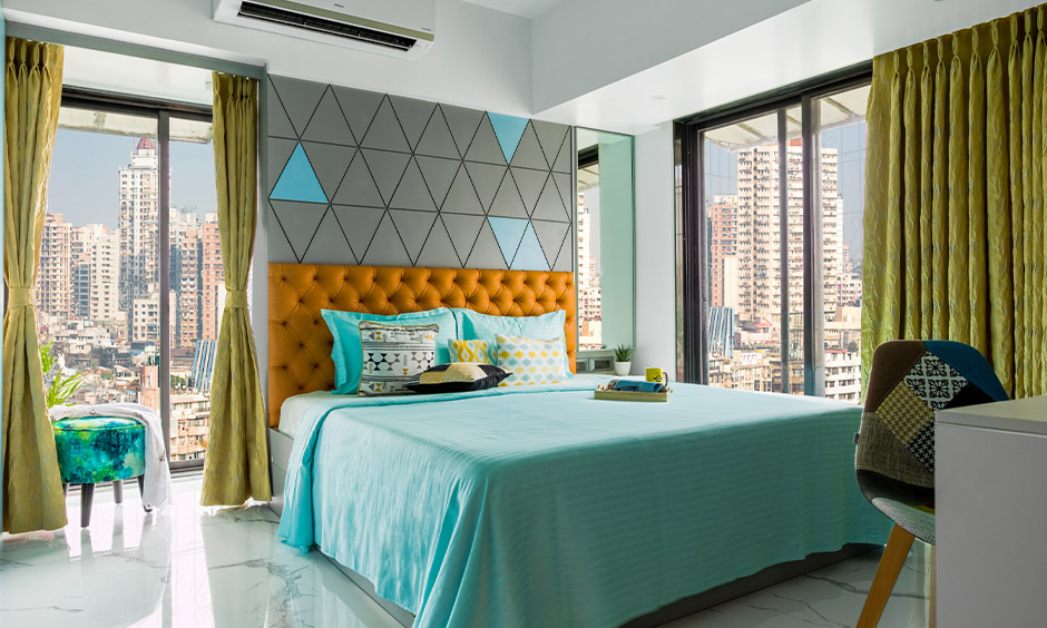 A bedroom with big windows designed by one of the best interior stylist mumbai