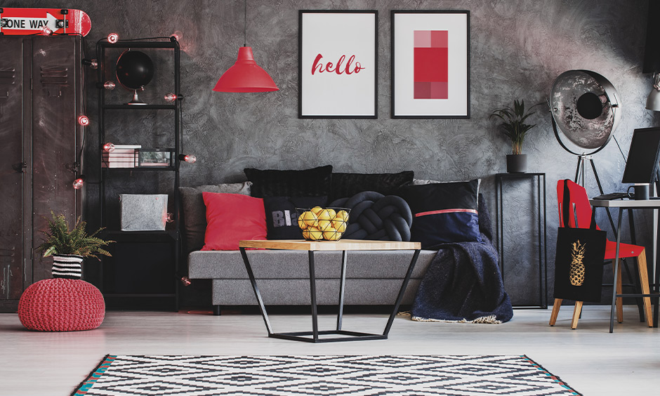 Red color living room decor, grey living room with pops of red colours light, cushion and chair lends colourfulness.