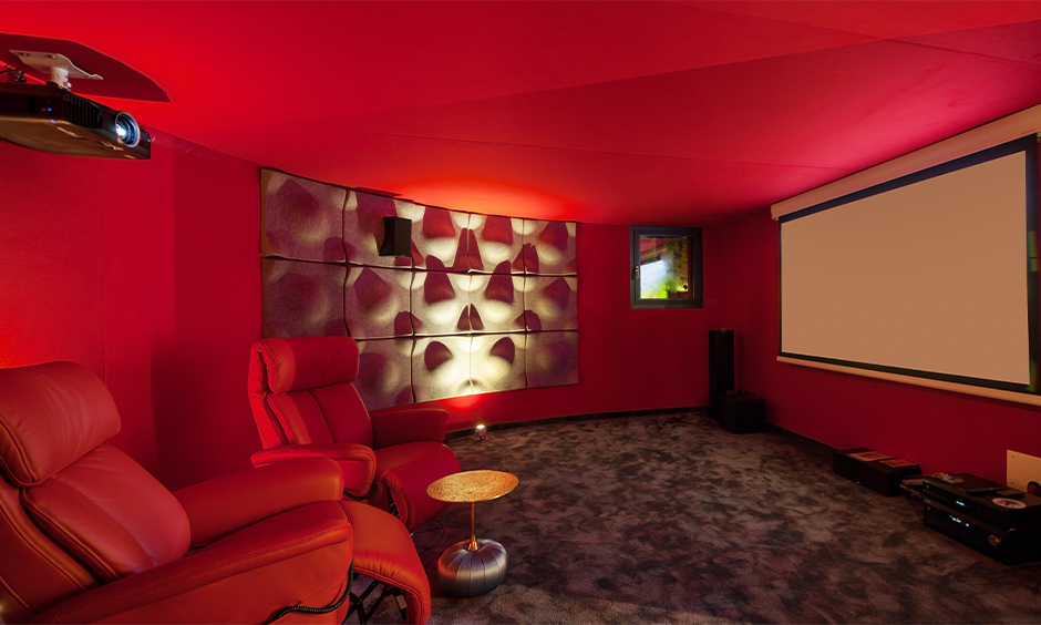 Red living room home theatre with two red recliner chairs brings luxury feel is red interior design living room.