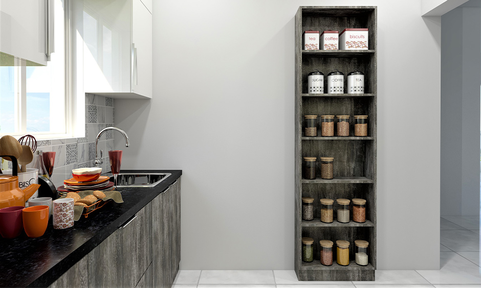 Tall wood kitchen pantry cabinet with open shelves against white wall lends a rustic look to the area.