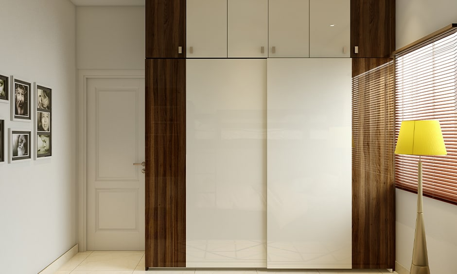 Simple white bedroom cupboards with a glossy finish gives a royal touch