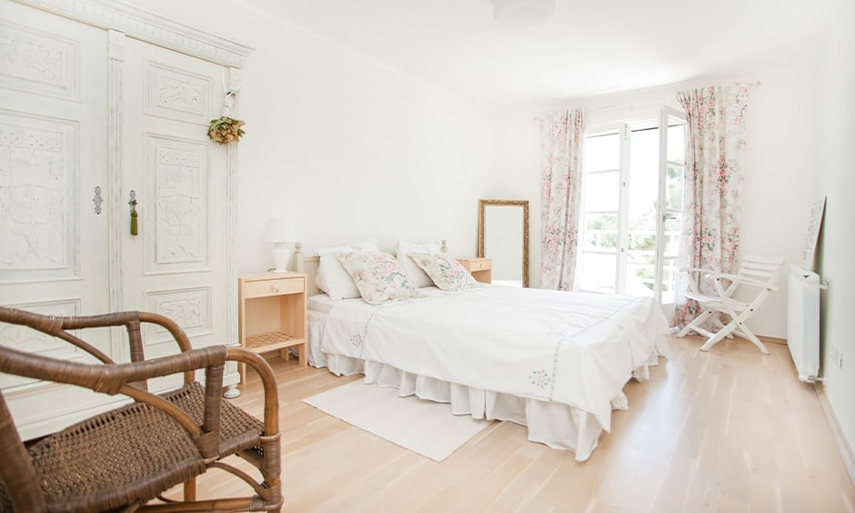 White bedroom cupboards giving a solid wooden look