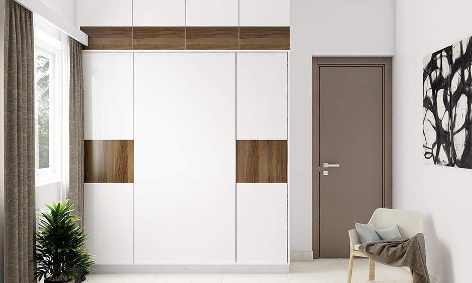 White bedroom cupboards with wooden laminates makes beautiful white cupboards