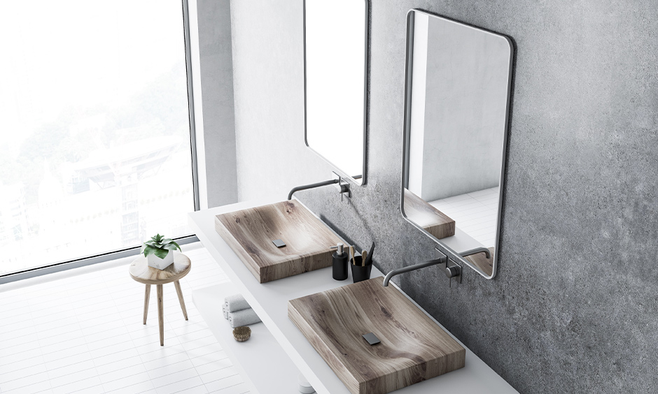 Brown wash basin colour made from wooden with floating storage in the bathroom looks aesthetic.