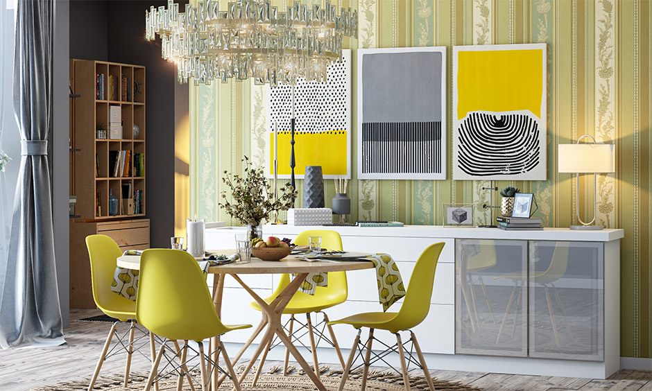 Dining area designed with a balance of bright yellow and matte grey pantone color of the year
