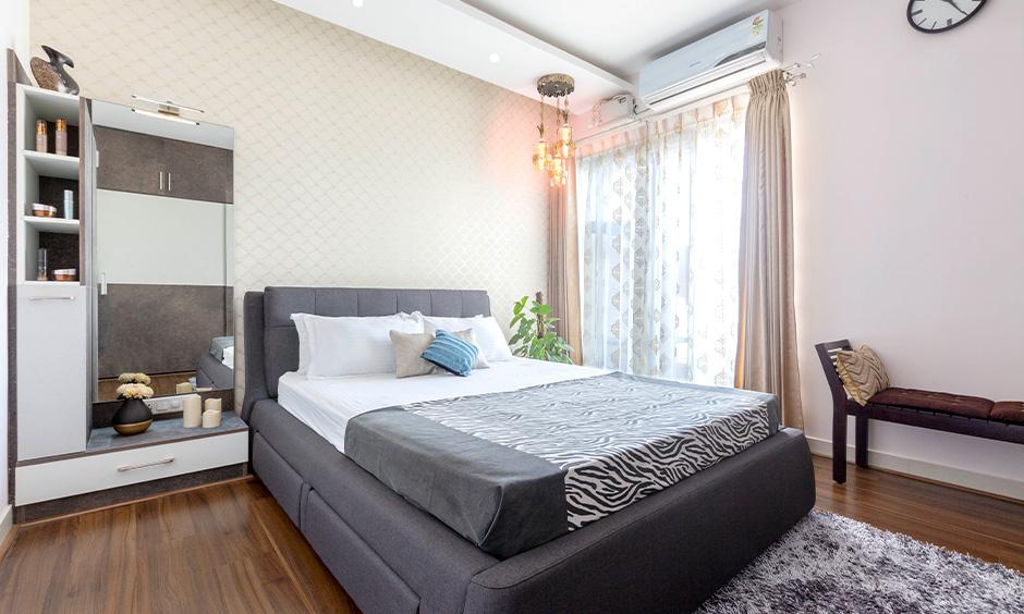 Budget interior designer in Marathahalli Bangalore designed bedroom with dressing unit and ceiling lights.