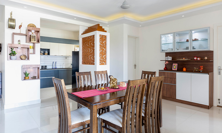 Best interior designer in Marathahalli designed this dining room with a classic dining table and display-cum-crockery unit.