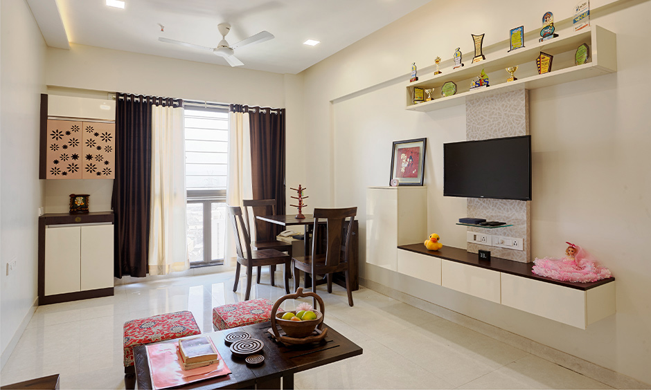 Dining cum living room designed in a minimalist style, the home interior contractor in Mumbai.
