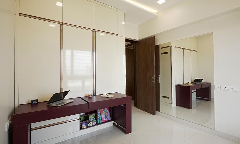 DC designed kids' bedroom with sliding study table in the wardrobe, Interior designer for Atmosphere Blanca.