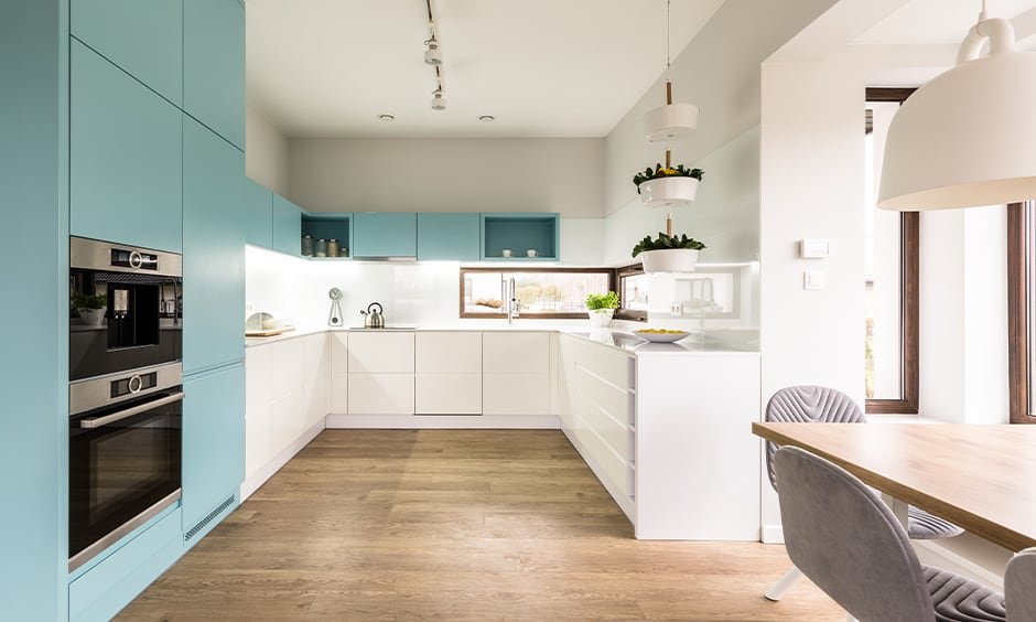 Baby blue kitchen cabinets with the wooden flooring