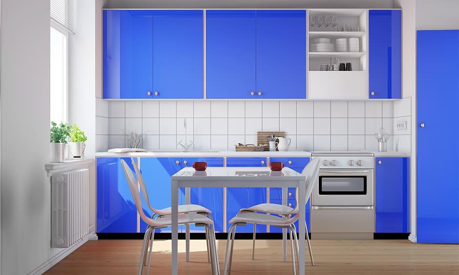 Bright blue kitchen cabinets creates quite a fun with this blue kitchen cabinets