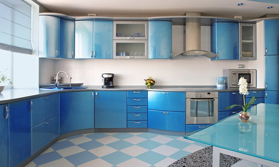Cornflower blue kitchen cabinets with darker shades of the colour creates visual appeal in the kitchen
