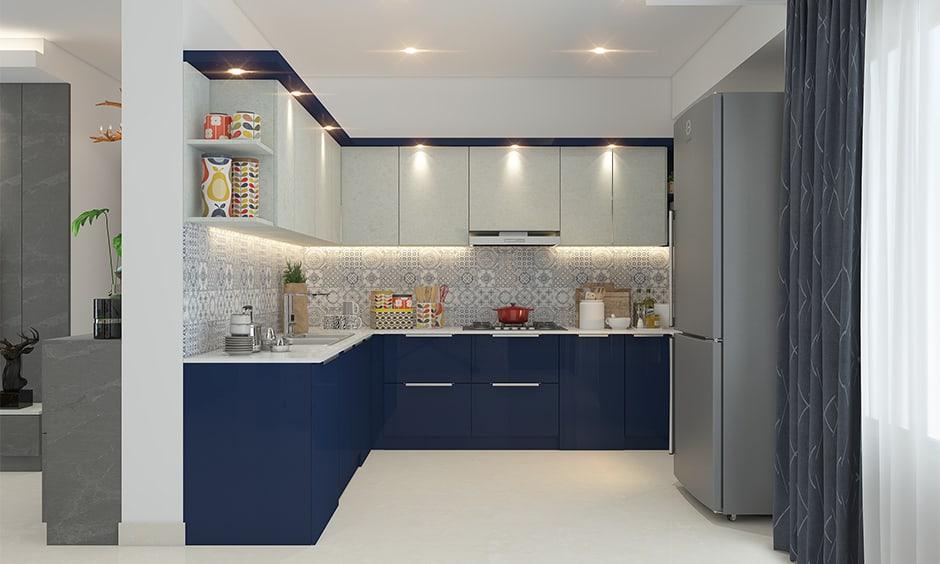 Navy blue kitchen cabinets creates sleek and stylish look in the kitchen interiors