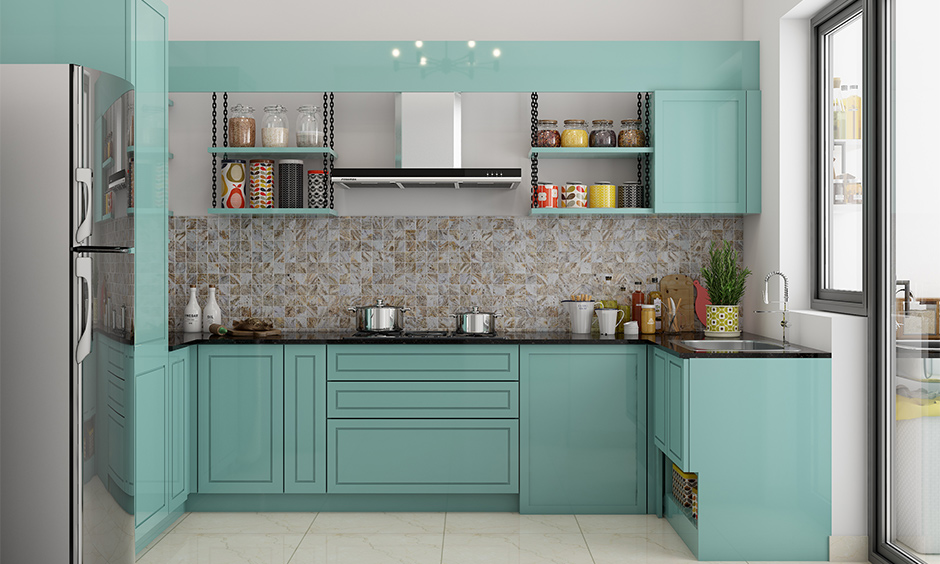 Above kitchen cabinet decorated with a layered panel enhances the look of the kitchen.