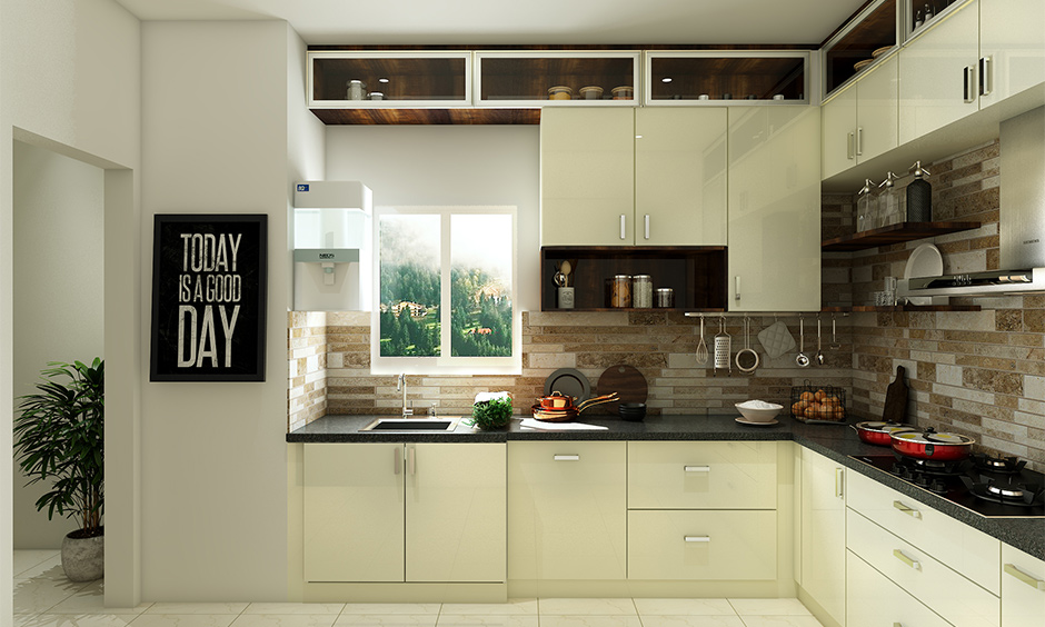 Above kitchen cabinet glass showcase integrated and dinnerware placed inside it as a showpiece is kitchen cabinet decor.