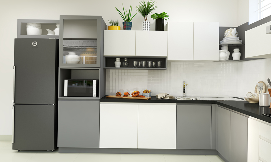 Above cabinet arranged mini indoor plants in the l-shaped white kitchen is how to decorate above kitchen cabinets.