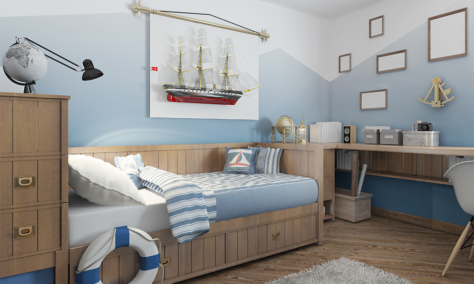 Sea themed room decorated with vintage ship art, cabin-themed bed and table is how to decorate boys room.