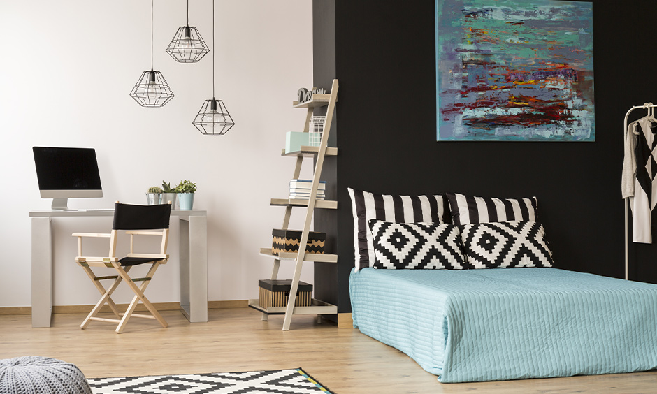 White and dark grey coloured small studio with minimalist style is the answer of how to decorate a small studio apartment for women.
