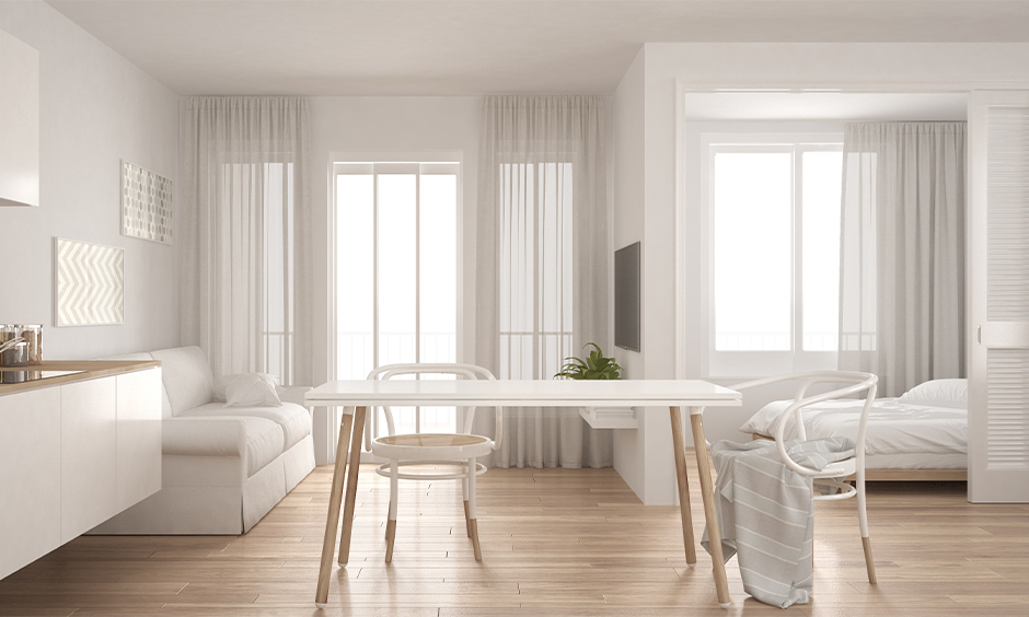 Cosy all-white living, dining and bedroom with sliding door is a multifunctional area, studio apartment decorating tips.
