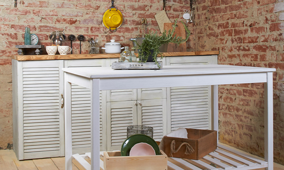 Metal kitchen cart on wheels like a dining table where you can have a quick meal
