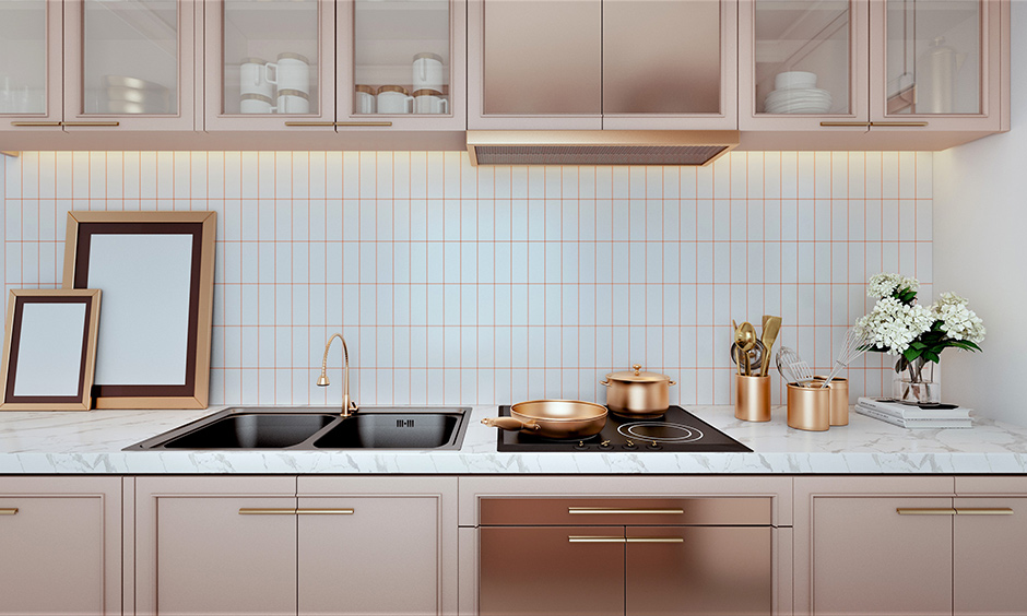 Black double bowl kitchen sink set within the rose gold kitchen interiors