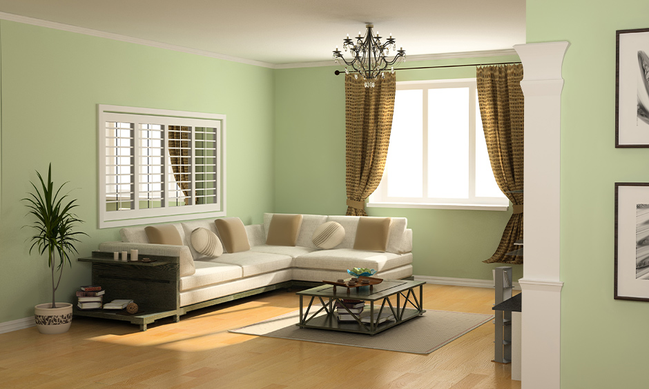 Living room with brown curtain against pistachio coloured walls look good; that is colour curtains go with green walls