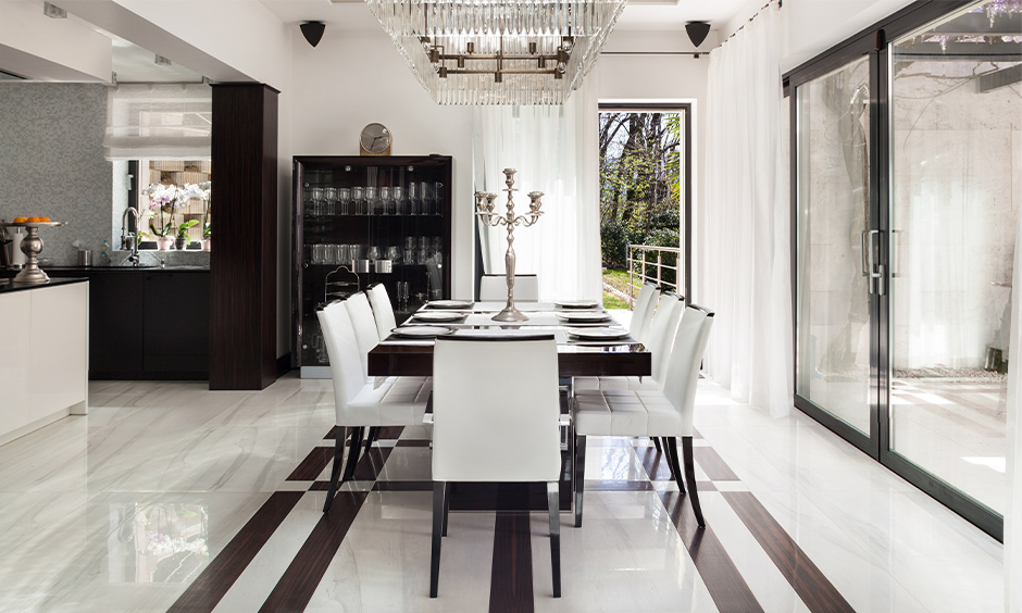 Dining area flooring in monochrome white marble designed in a checkered pattern is the best white marble for flooring.