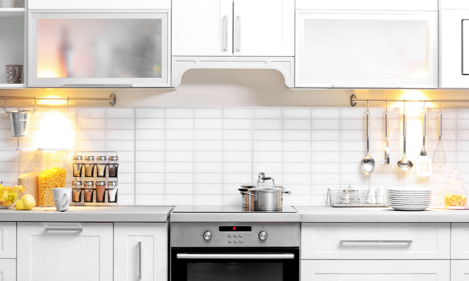 All-white kitchen under cabinet lighting with bright lamps is simple yet classic.