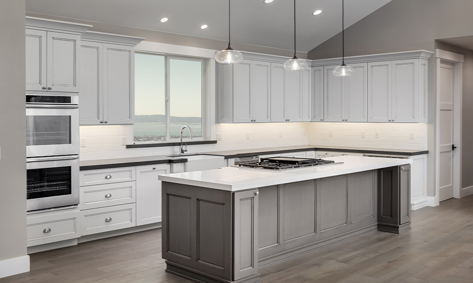 White and grey island kitchen with under cabinet kitchen lighting option in white light is a classic look.