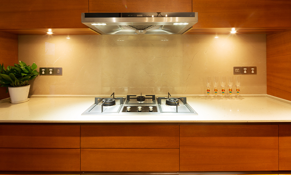 The kitchen with lights under the wooden cabinet next to the chimney is simple wireless led lights for kitchen cabinets.