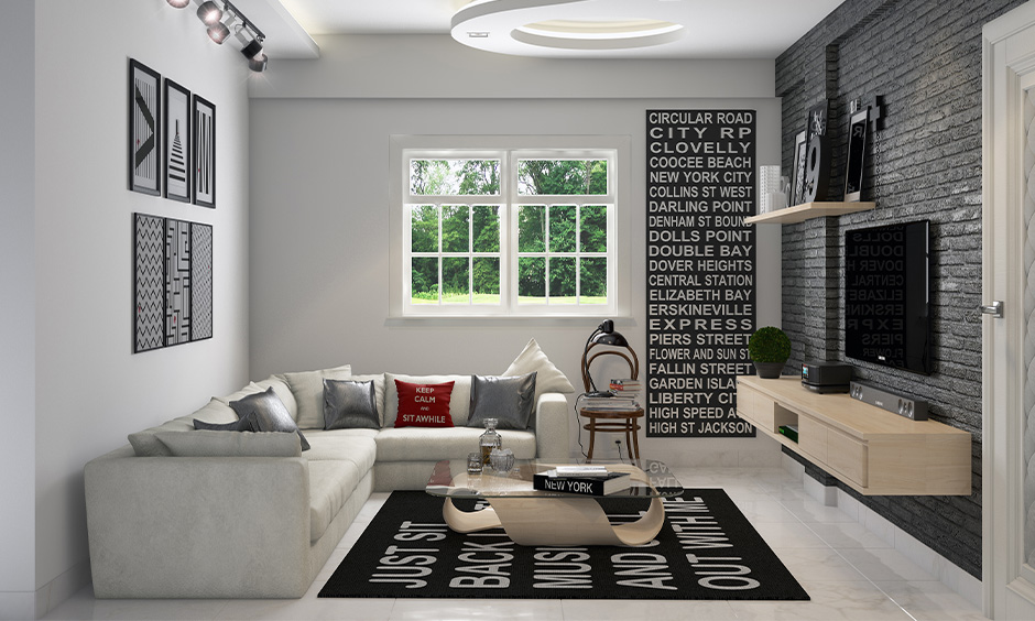 Small living room monochrome analogous colour scheme painting look is classy with l-shape sofa and tv unit.